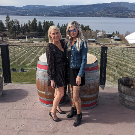 2 women on patio at summerhill pyramid winery during a kelowna half day morning wine tour